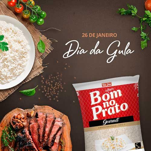 """Imagem mostra um prato de arroz branco, a frase """"26 de janeiro Dia da Gula"""" e a embalagem do arroz branco da Marca Bom no Prato"""
